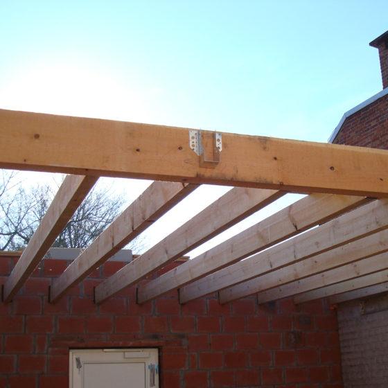 Réalisation charpente toit plat